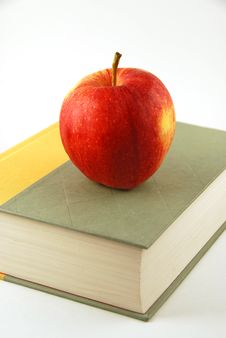 Free Apple On A Book Royalty Free Stock Photo - 7849065