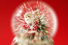 Free Santa Claus Figurine On A Glass Snowing Ball Royalty Free Stock Image - 7852456