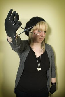Free Woman Holding Forceps In Front Of Her Face Stock Photo - 7852870