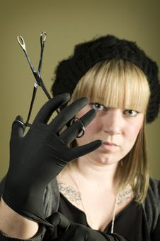 Free Woman Holding Forceps In Front Of Her Face Royalty Free Stock Photography - 7852887