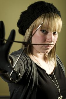 Free Woman Holding Forceps In Front Of Her Face Stock Photos - 7852893