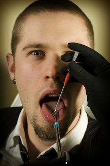 Man About To Get His Tongue Pierced Stock Photography
