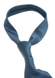 The Dark Blue Tie Is On A White Background Royalty Free Stock Photos