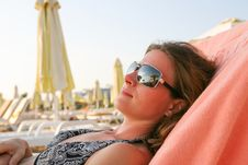 Free Woman Sunbathing On The Beach Royalty Free Stock Photos - 7855228
