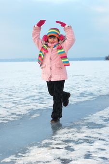 Child On Icy River Stock Images