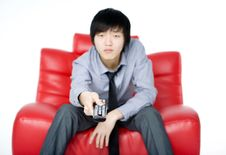 Free The Young Man In A Grey Shirt Watches TV Royalty Free Stock Photo - 7856085