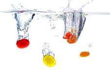Free Colored Sugarplums Falling Into The Water Stock Photography - 7857812