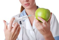 Free Nurse With Syringe And Apple Royalty Free Stock Photography - 7858557