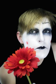 Free Gloomy Mime With  Red Flower Stock Photography - 7860152