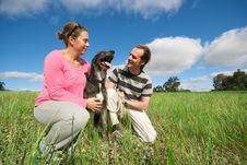 Free Couple With Dog In Field Royalty Free Stock Photo - 7867015