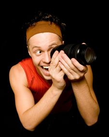 Free Young Man Looks Through Camera Lens Stock Images - 7868364