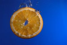Orange Slice In Water Stock Images