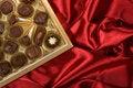 Free Chocolates Box On Red Satin Stock Photos - 7874233