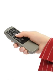 Womanish Hand Holds Remote Control Unit Royalty Free Stock Images