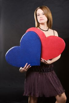 Girl In Dress Holding Two Hearts Stock Image