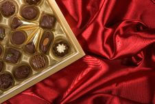 Free Chocolates Box On Red Satin Stock Photos - 7874233