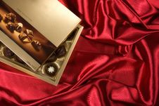 Free Chocolates Box On Red Satin Stock Photo - 7874330