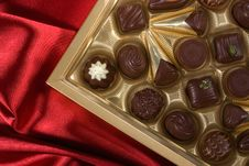 Free Chocolates Box On Red Satin Royalty Free Stock Photo - 7874345