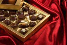 Free Chocolates Box On Red Satin Royalty Free Stock Image - 7874366