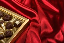 Free Chocolates Box On Red Satin Stock Photos - 7874373