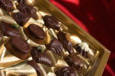 Free Chocolates Box On Red Satin Royalty Free Stock Photography - 7874477