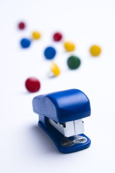 Free Blue Stapler On White With Thumb Tacks. Stock Images - 7874514