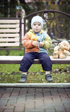 Free Baby On The Bench Stock Photography - 7876152