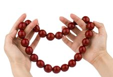 Free Red Beads In Hands Stock Photography - 7876312