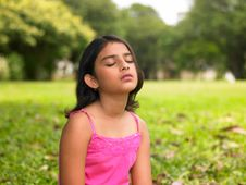 Free Asian Girl Sitting In The Park Stock Photography - 7878392