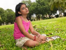 Free Asian Girl Sitting In The Park Stock Photo - 7878630