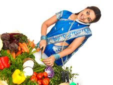 Free A Woman Cutting Vegetables And Talking In The Phon Stock Photos - 7878733
