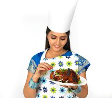 Female Chef With Her Roasted Chicken Stock Photo