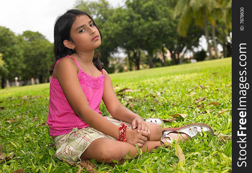 Asian girl sitting in the park