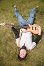 Free Young Man  Lies With Guitar Stock Photography - 7888762