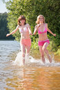 Free Two Girl Runs On Water Stock Photography - 7889012