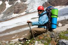 Backpacker Girl With Ice-axe Royalty Free Stock Photos