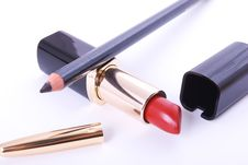 Red Lipstick And Black Crayon Royalty Free Stock Images