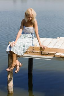 Free Girl Sitting On A Pier Stock Photography - 7883252