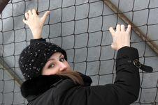 Girl Climbs A Net Royalty Free Stock Photos