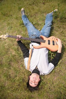 Young Man  Lies With Guitar Stock Photography