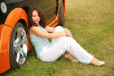 Free Girl Sits On Grass Near Car Royalty Free Stock Photos - 7888848