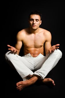 Free Young Man In Lotus Yoga Position Isolated On Black Royalty Free Stock Image - 7889376