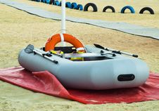 Inflatable Rescue Boat. Gray Inflatable Boat On The Beach In The Sand Royalty Free Stock Photo