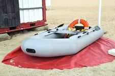 Inflatable Rescue Boat. Gray Inflatable Boat On The Beach In The Sand Royalty Free Stock Photos