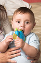 Free Child Nibbling A Toy Royalty Free Stock Photo - 7894435