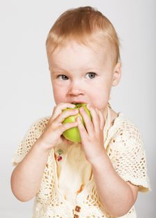 Little Girl Eating An Apple Royalty Free Stock Photos