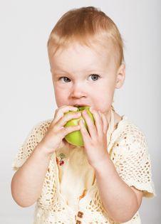 Little Girl Eating An Apple Royalty Free Stock Photos