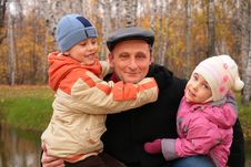 Free Grandfather With Children In Autumnal Park Stock Images - 7891894