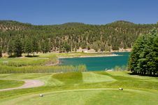 Free An Aqua Lake Near A Golf Hole Stock Photos - 7892883