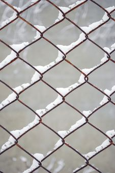 Free Rusty Wire Fence Under Snow Stock Image - 7896271